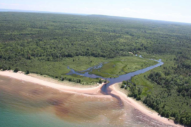 Aerial view of the mouth of the Laughing Whitefish River and Lake Superior shoreline